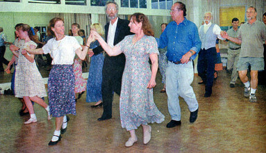 Dancers participate in Ellen Riley's English country dance class in Poway